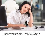 tired young woman is sitting at ... | Shutterstock . vector #242966545