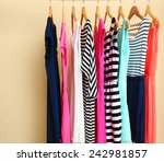 female dresses on hangers in... | Shutterstock . vector #242981857