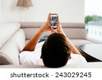 man browsing internet on his... | Shutterstock . vector #243029245