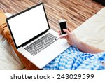 laptop and smartphone mockup.... | Shutterstock . vector #243029599
