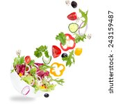 fresh salad with flying... | Shutterstock . vector #243159487