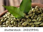 green coffee beans in wooden... | Shutterstock . vector #243159541