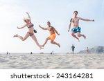 group of three friends jumping... | Shutterstock . vector #243164281