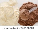 Stock photo close up of protein powder and scoops 243168601