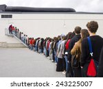 large group of people waiting... | Shutterstock . vector #243225007