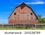An Old Red Barn In A Farm Yard...
