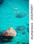 crystal clear blue sea with two ... | Shutterstock . vector #243294097