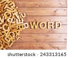 Small photo of Word word made with block wooden letters next to a pile of other letters over the wooden board surface composition
