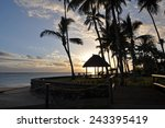 Stock photo the tranquil beaches of the south pacific ocean really are paradise found this sunset is over the 243395419