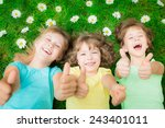 happy children lying on green... | Shutterstock . vector #243401011