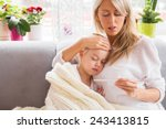 mother checking temperature of... | Shutterstock . vector #243413815