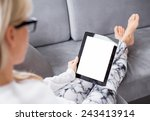 woman reading ebook on tablet... | Shutterstock . vector #243413914