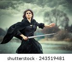 the beautiful gothic girl holds ... | Shutterstock . vector #243519481