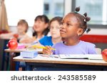 row of students in a primary... | Shutterstock . vector #243585589
