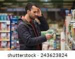 man looking confused at mobile... | Shutterstock . vector #243623824