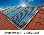 vacuum collectors  solar water...   Shutterstock . vector #243692335