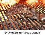 beef steak and spatula on hot... | Shutterstock . vector #243720835