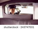 limousine driver smiling at...