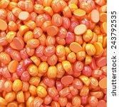 orange bonbons candy in bulk. | Shutterstock . vector #243792535