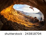 Young Woman Lead Climbing In...