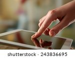 hand using tablet pc on wooden... | Shutterstock . vector #243836695