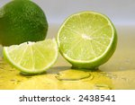 freshly cut limes  with lime... | Shutterstock . vector #2438541