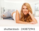 young woman relaxing in bed | Shutterstock . vector #243872941