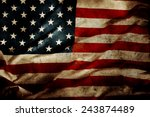 closeup of grunge american flag | Shutterstock . vector #243874489