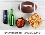 tv remote  beer bottle  bowl of ... | Shutterstock . vector #243901249