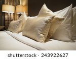Stock photo image of comfortable pillows and bed 243922627