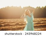 sweet girl in the rays of the... | Shutterstock . vector #243968224