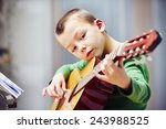 little boy is playing the... | Shutterstock . vector #243988525