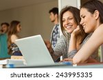 smiling friends sitting using...   Shutterstock . vector #243995335