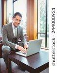 smiling handsome businessman... | Shutterstock . vector #244000921