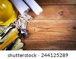 hammer  protective gloves ... | Shutterstock . vector #244125289