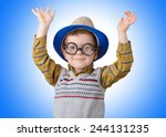 boy in a funny hat and glasses... | Shutterstock . vector #244131235