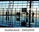 travelers silhouettes at airport | Shutterstock . vector #24416545