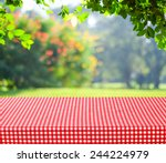 empty table and red tablecloth... | Shutterstock . vector #244224979