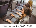 call centre agents talking on... | Shutterstock . vector #244310101