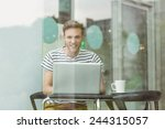 smiling student using laptop in ... | Shutterstock . vector #244315057