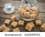 Brown Sugar Cubes And Jar On...