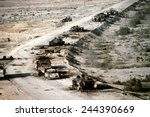 Iraqi armored personnel carriers tanks and trucks destroyed in a Coalition attack along a road in the Euphrates River Valley during Operation Desert Storm. March 4 1991