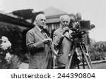 Thomas Edison 1847-1931 and George Eastman 1854-1932 standing with motion picture camera ca. 1925. - stock photo