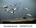 Small photo of Aircraft assigned to the nuclear-powered aircraft carrier USS GEORGE WASHINGTON fly over the ship. Oct. 25 1992.