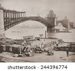 St. Louis Bridge under construction ca. 1870. The steel arches were cantilevered from opposing piers high above the river. The bridge