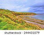 Cove Bay With Cliffs On The...