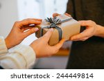 young woman gives a gift in a... | Shutterstock . vector #244449814