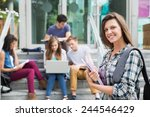 pretty student smiling at... | Shutterstock . vector #244546429
