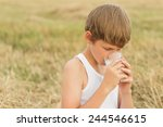teenage boy holding a... | Shutterstock . vector #244546615
