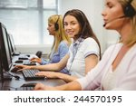 smiling call centre agent... | Shutterstock . vector #244570195